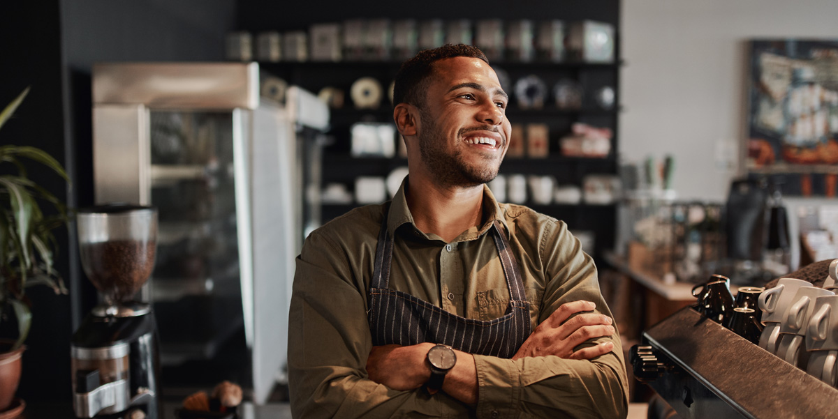 Small Businessman in Coffee Shop learning tips for financial success